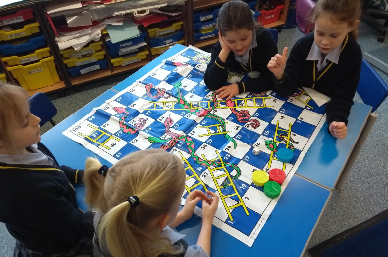 Playing snakes and ladders at Burgess Hill Girls